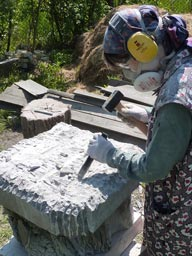 Basic shaping of limestone block with use of protective equipment
